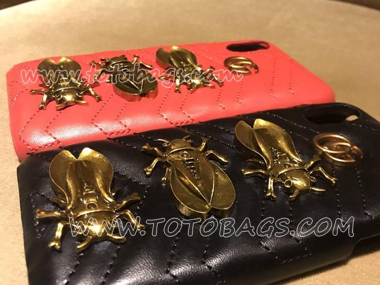 金属蛾スタッドと「GG」ロゴとmatelass革でグッチの携帯電話ケース